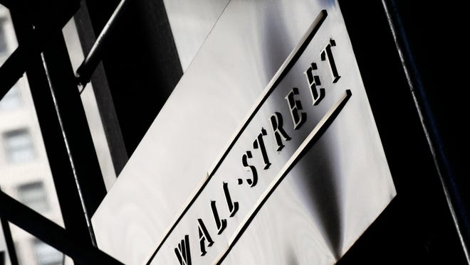 This July 15, 2013, file photo, shows a sign for Wall Street outside the New York Stock Exchange.  (AP Photo/Mark Lennihan, File)