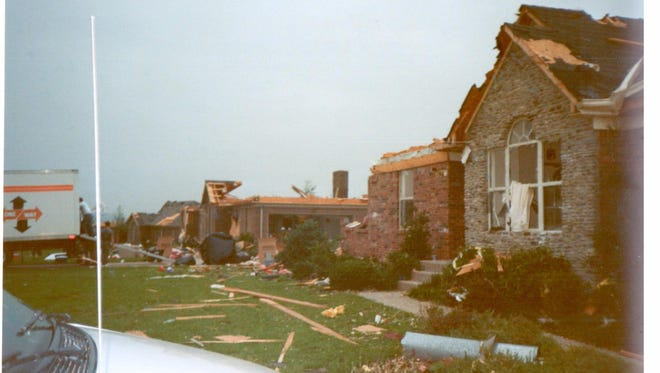 The 1996 tornado tore through Pioneer Village, but neighbors banded together to help one another.