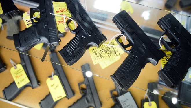A selection of handguns sits on display in a glass case Tuesday at On Target Shooting Range off Sweeten Creek Road.