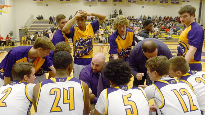 North Henderson coach Justin Parris talks to his team Tuesday night in Hendersonville