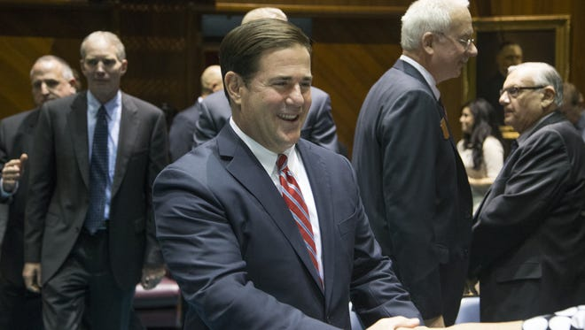 Governor Doug Ducey enters the House of Representatives before giving his State of the State address, January 11,2016, at the Arizona Capitol, 1700 W. Washington Street, Phoenix.