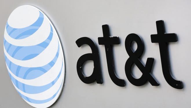 This photo taken April 21, 2015, shows the corporate logo for AT&T on the outside of one of its New York facilities.