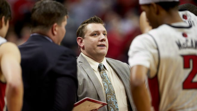 Lansing area native Todd Simon, 35, has taken over as the interim head basketball coach at UNLV. His first game was Tuesday night against New Mexico.