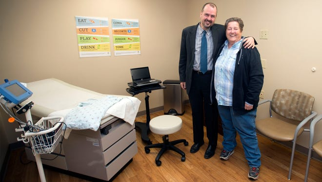 Dale Fell Health Center CEO Nicholas Apostoleris and board member Sioux Free stand for a picture inside an exam room, inside the new clinic located at at 7 McDowell Street Asheville. The clinic is set to open Feb. 8.