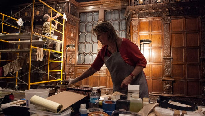 Thom Gentle and Eva Burnham reassemble the English Renaissance Room on Friday morning as part of the Speed Art Museum renovation process. 1/15/16