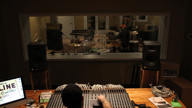 Daytrotter sound engineer Mike Gentry prepares for a session with the Nashville-based Keeps at Daytrotter in Davenport on Friday, Jan. 15, 2016.