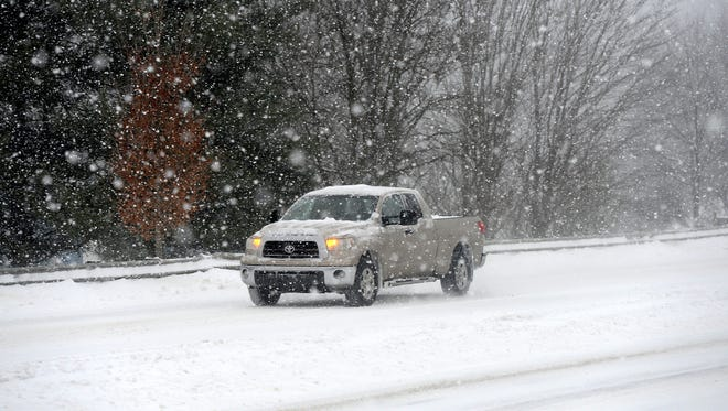 Home healthcare services create contingency plans for reaching patients, even when roads are covered in snow, as they were Friday morning, when this truck made its way down New Leicester Highway.