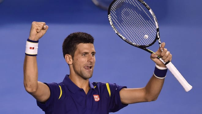 Serbia's Novak Djokovic celebrates victory during his men's singles semi-final match against Switzerland's Roger Federer at the Australian Open on January 28, 2016.