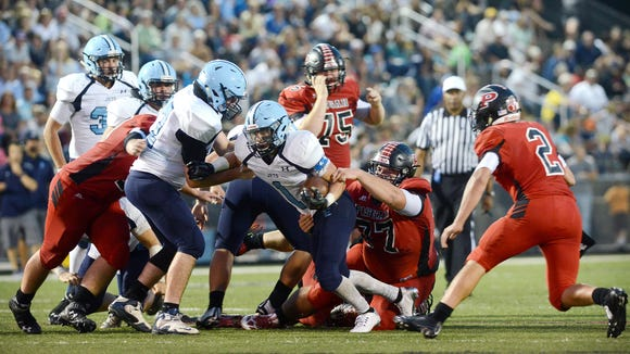 David Mackey (77) tries to make a tackle for Pisgah in last year's football game against Enka.