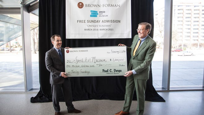 Ghislain d'Humières and Jim Welch pose with a check in the amount of $1 million dollars which will allow free Sunday admission at the Speed Art Museum for five years. 2/23/16