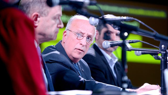 Panelist Dennis King, president of Asheville-Buncombe Technical Community College, answers a question during the Asheville Citizen Times Thrive Live event to discuss the Connect NC Bond at The Millroom on Thursday, Feb. 25, 2016.