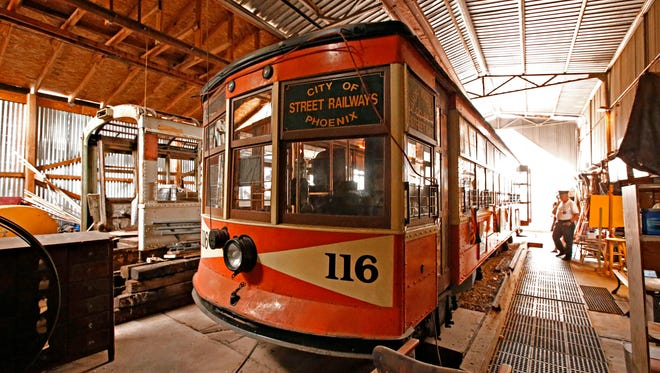 Ernie Workman, president of the Phoenix Trolley Museum in downtown Phoenix, points out features on the refurbished 116 street car on Feb. 18, 2016.  Two of Phoenix's last historical trolleys are headed to an unknown destination as the vehicles are expected to lose their longtime home downtown because of changes at Hance Park.