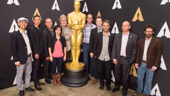 From left: Animated Feature Film nominees Hiromasa Yonebayashi and Yoshiaki Nishimura ('When Marnie Was There'), Jonas Rivera ('Inside Out'), Rosa Tran ('Anomalisa'), Richard Starzak, ('Shaun the Sheep Movie') Pete Docter ('Inside Out'), Duke Johnson ('Anomalisa'),  Alê Abreu ('Boy and the World'), Mark Burton ('Shaun the Sheep Movie') and Charlie Kaufman, ('Anomalisa') prior to the Oscar Week: Animated Features event on Thursday.