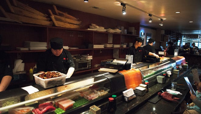 Chefs work with fresh seafood and other ingredients at  Wasabi Japanese restaurant, 19 Broadway St., Asheville.