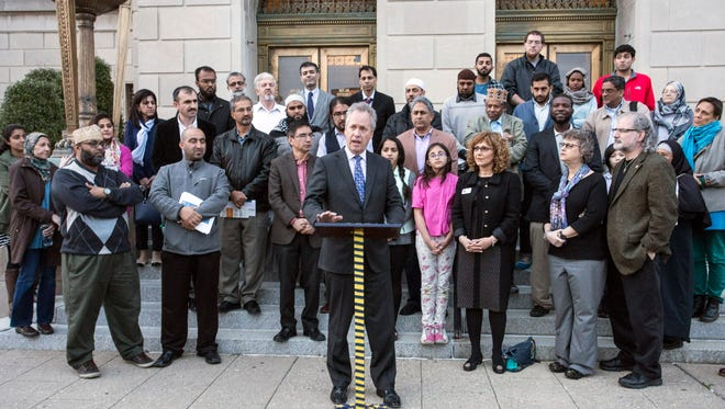 Mayor Greg Fischer took part in a Tuesday rally to address global terrorism versus the peaceful nature of Louisville's own Muslim community. 3/22/16