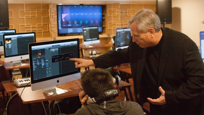 Steven Meredith, director of choral activities and music technology at SUU, instructs a student in the Center for Music Technology.