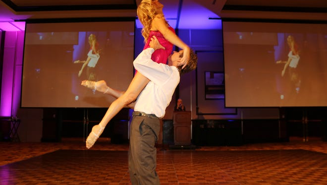 Kytti St. Amand and Van Spencer win first place trophy in Dancing With Our Stars