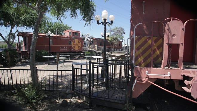 The 1988 Tempe Railroad Plaza was Ron Lundeen's dream to repurpose retired cabooses into a unique office park. Adjacent to Macayo's Depot Cantina in Tempe, the cars are now rented for special events and parties.