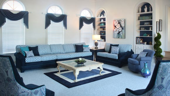 A favorite couch re-upholstered in an updated fabric is the centerpiece of a new design.