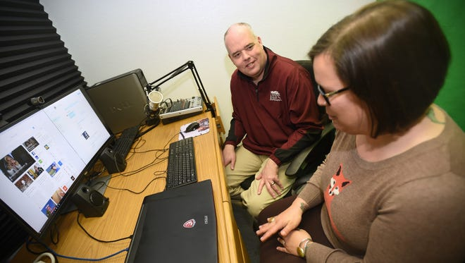 NMSU business professor and Sheriff Chair for Entrepreneurship Robert Macy, left, works with Lauren Goldstein in a recording studio used for web and podcasting at the Arrowhead Center on campus.