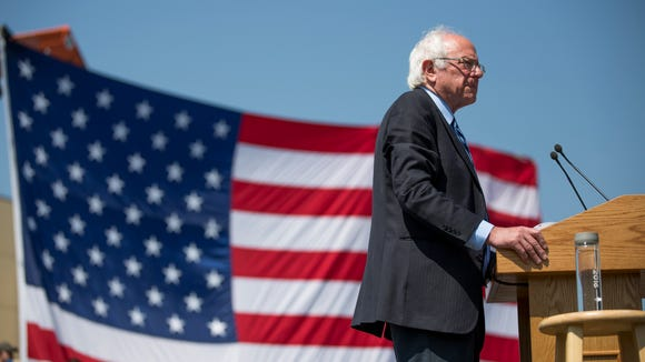 Bernie Sanders pauses while speaking during a campaign