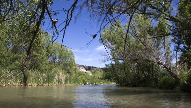 Kayakers paddle, May 11, 2016, down the Verde River near Camp Verde.