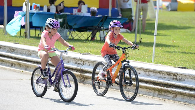 The Mountain Sports Festival continued Saturday with the Second Annual Down River SUP Race, kids duathlon, live music and more at Carrier Park.