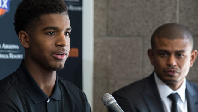 Marquese Chriss (left) answers questions, June 24, 2016, during a press conference in the Van Arsdale Conference Room at Talking Stick Resort Arena, 201 E. Jefferson Street, Phoenix, Arizona. Looking on is Suns coach Earl Watson.