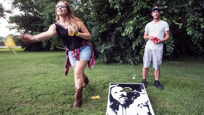 Rachel and Chris Young take advantage of the Lebowski-themed cornhole set during opening night of the 15th annual Lebowski Fest.