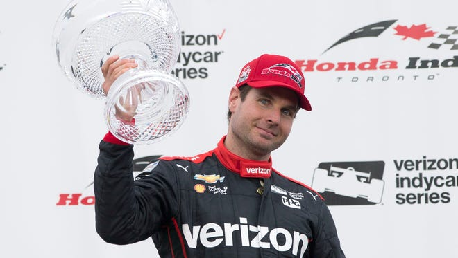 Australian driver Will Power celebrates winning the IndyCar auto race in Toronto on Sunday, July 17, 2016.