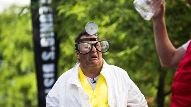 Leland Faulkner of SNAFU! reacts during a performance on Church Street during the 2016 Festival of Fools.