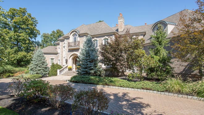 This five-bedroom mansion in Warren has spacious rooms on three levels of living space.