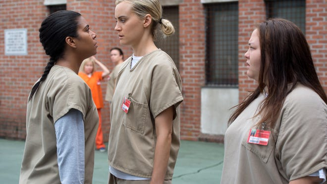 "Taylor Schilling, center, Jolene Purdy and Jessica Pimentel in ""Orange Is the New Black."""