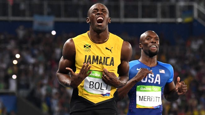 There was little doubt in the outcome of the 200 meters after Jamaica's Usain Bolt, left, gobbled up the first 50 meters of the race.