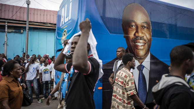 Supporters of Gabonese President Ali Bongo Ondimba gather in Libreville during a campaign stop on Aug. 25, 2016, ahead of Saturday's presidential election.