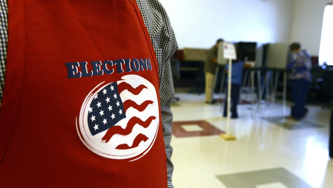 A campaign worker stands guard at a polling place near Warren Wilson College in 2014..