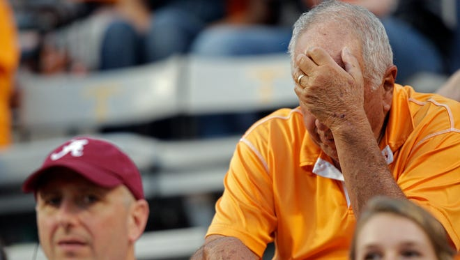 A Tennessee fan can't watch during the second half against Alabama on Oct. 15, 2016.