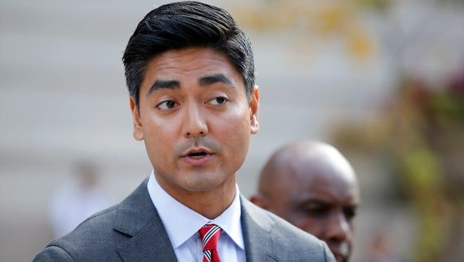 Aftab Pureval, candidate for Hamilton County Clerk of Courts, speaks Monday October 17, 2016 outside of the Hamilton County Courthouse about an article City Beat wrote about emails sent from Tracy Winkler and her campaign. Allegedly Winkler sent emails requesting employees to work on her campaign.