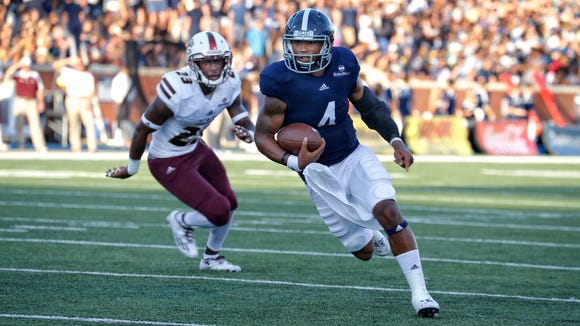 Georgia Southern quarterback Kevin Ellison and the Eagles are taking to the passing game more often under a first-year head coach.