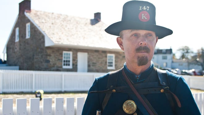 Pvt. Brucy Clark of the147th Co. K New York Infantry poses along the western side of the Mary Thompson House at Seminary Ridge Friday in Gettysburg. The home was used by Gen. Robert E. Lee during the Battle of Gettysburg. During the battle, the 147th New York attempted to defend the Union line on this property, but lost it to the Confederates by the end of July 1, 1863.