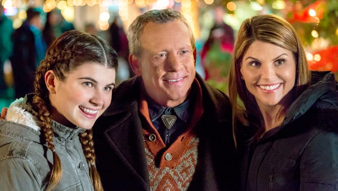 Isabella Giannulli, left, Willie Aames, and Lori Loughlin star in 'Every Christmas Has a Story.'