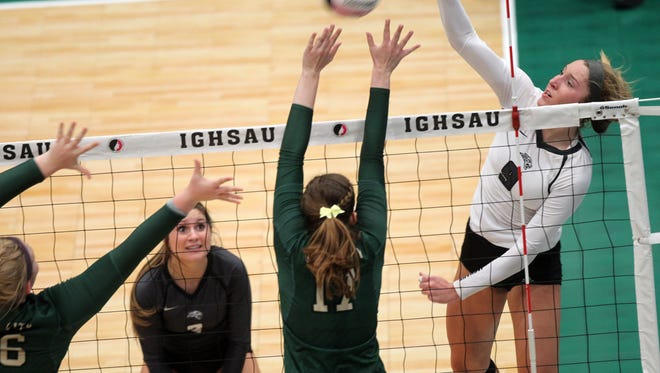 Ankeny Centennial's Kenna Sauer goes for a kill during the Jaguars' Class 5A state tournament quarterfinal game against West High at the U.S. Cellular Center in Cedar Rapids on Tuesday, Nov. 8, 2016.