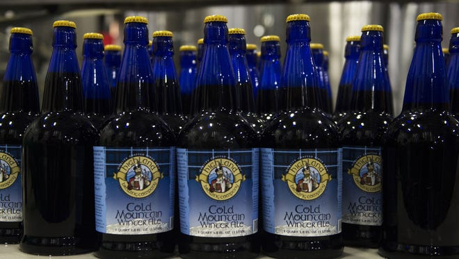 Cold Mountain bottles lined up at Highland Brewing in 2014. This year, the brew goes on sale Nov. 10