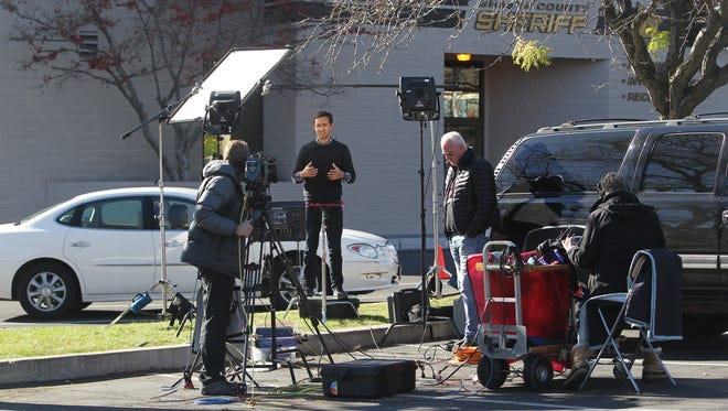 A team from NBC News works in front of the Shasta County Sheriff's Office Thursday in Redding.