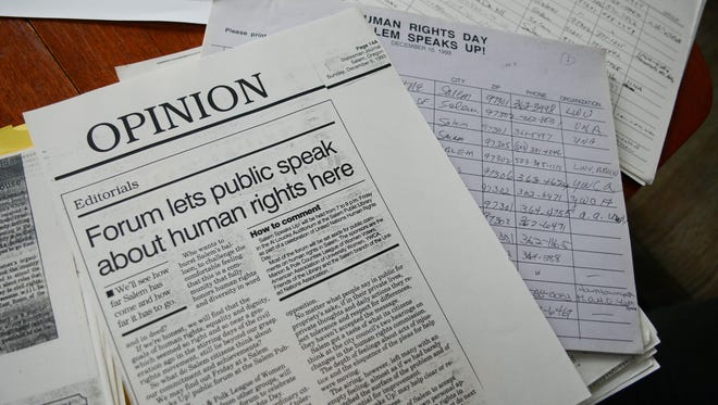 Rose Lewis sorts through old Salem Speaks Up! fliers and articles. Salem Speaks Up! is an event held on United Nations Human Rights Day. It's designed to offer an open microphone opportunity for people who have experienced human rights violations.