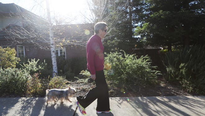 Bonnie Smith walks around her Redding neighborhood.