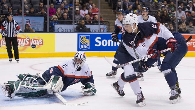 United States' Tanner Laczynski (10) scores on Slovakia goaltender Matej Tomek Wednesday. Both are Flyers draft picks.