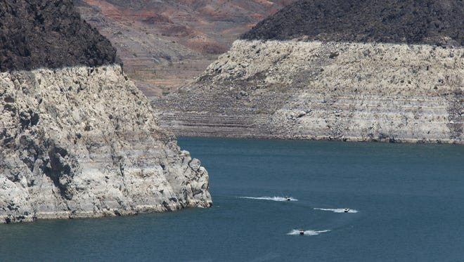 A high-water mark is visible on the shoreline of Lake Mead, indicating a significant long-term drop in the water levels.