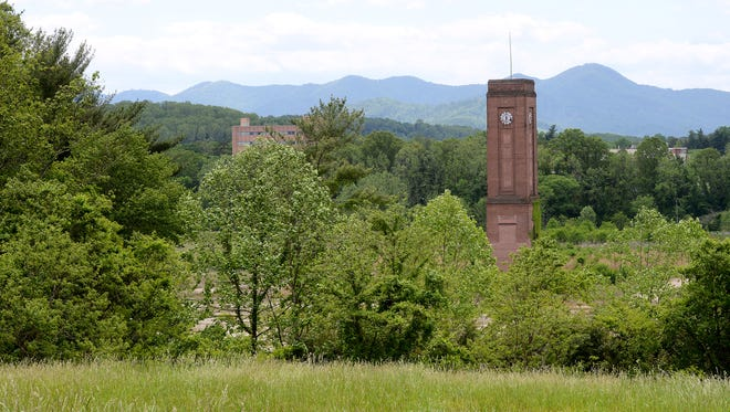 A view of the Enka clock towerfrom the site of a former BASF Corp. landfill off Sand Hill Road in Enka.