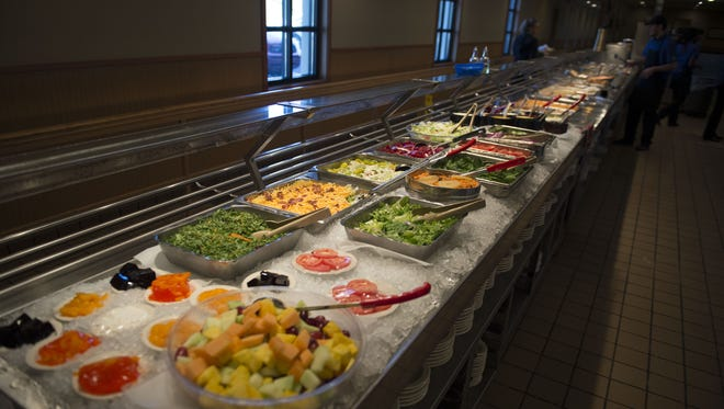 A salad bar sits ready for the lunchtime rush at J&S Cafeteria.